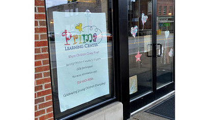 Prima Learning Center sign in the window of 735 Midland Ave.