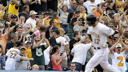 Fans cheer for Clint Barmes after he hit a grand in the fourth inning.