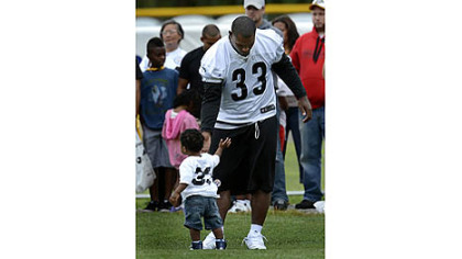 Isaac Redman spends some time with his son, Haiden, Saturday at camp at Saint Vincent College.
