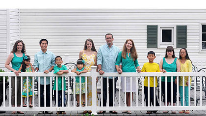 The Clark family at their home in McKeesport: From left, Amanda Barney, 28, Annie, 7, Tyler, 18, Travis, 10, Amelia, 4, Amy, 26, parents Tom, 49, and Mary Ellen, 48, Talbot, 10, Abbey, 21, and Alyssa, 18.