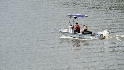 State park rangers search Moraine State Park's Lake Arthur for a missing man Monday. He was later found dead.
