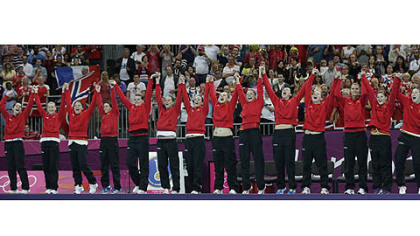 Players of Montenegro celebrate after winning the silver medal in women's handball at the 2012 Summer Olympics, Saturday, Aug. 11, 2012, in London.
