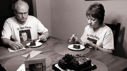 Barb and Duane DiPietro commemorate what would have been their son Justin's 27th birthday July 18 with his favorite cake, chocolate with chocolate icing, at their home in Manor, Westmoreland County.
