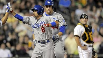 The Dodgers&#039; Shane Victorino is congratulated at home plate after hitting a two-run home run against the Pirates in the fifth inning Monday at PNC Park.