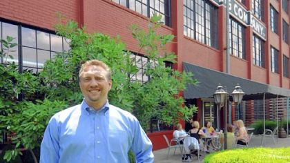 Orrick's Will Turani at the rear courtyard on what once was a railroad spur behind the firm's Wheeling offices.