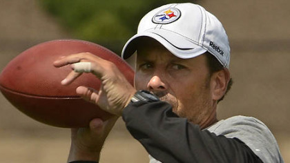 Steelers offensive coordinator Todd Haley drops back to pass during drills at training camp.