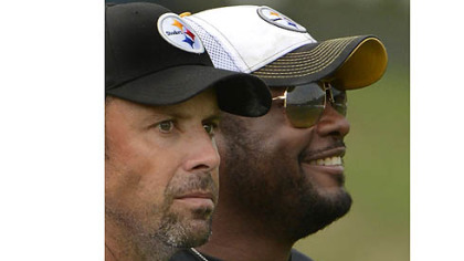 Steelers offensive coordinator Todd Haley alongside head coach Mike Tomlin looking over the new offense during afternoon workouts at training camp.