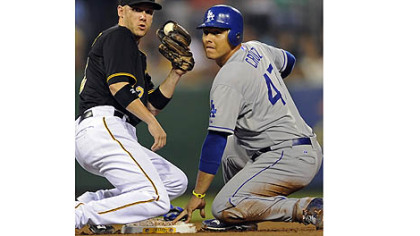 Dodgers' Luis Cruz gets into second base safely on a steal against Pirates' Clint Barmes in the third inning Tuesday night at PNC Park.
