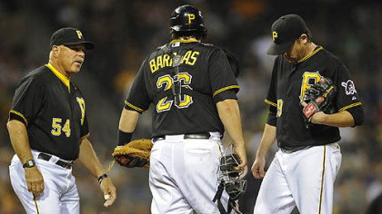 Pirates starting pitcher Kevin Correia gets a visit to the mound from pitching coach Ray Searage in the sixth inning Tuesday night at PNC Park.
