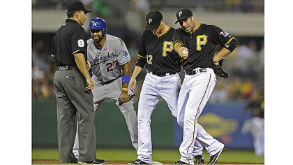 Pirates' Neil Walker argues a safe call at second base on Dodgers' Matt Kemp in the fourth inning Tuesday night at PNC Park.