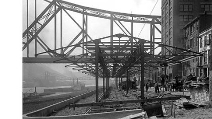 View of the farmers market when it was under construction on the Monongahela River wharf along Water Street in 1915.